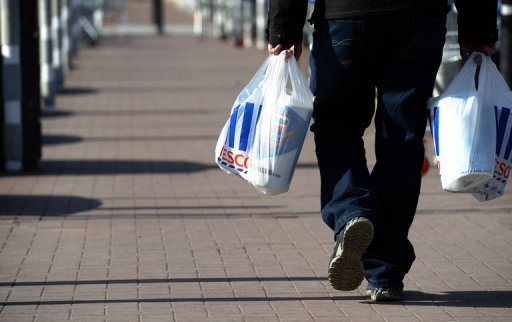 <p>A man carries shopping bags through the carpark of a Tesco Extra supermarket in Birkenhead, north-west England, on March 5. Annual inflation in recession-hit Britain slowed slightly to a rate of 2.5 percent in August, official data showed on Tuesday.</p>