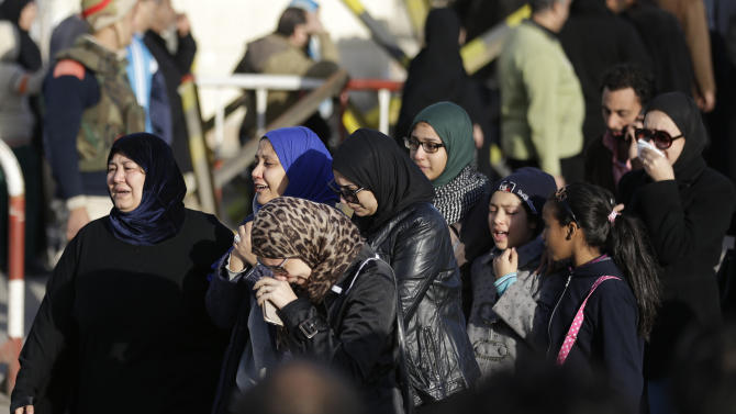 Family members of security forces killed in Sinai on Thursday cry after they received the bodies of their relatives, outside Almaza military airport in Cairo, Egypt, Friday, Jan. 30, 2015. Egyptian officials on Friday raised the death toll to at least 32 from coordinated and simultaneous attacks that struck more than a dozen army and police targets in the restive Sinai Peninsula the previous night. An Egyptian militant group affiliated with the Islamic State claimed responsibility for the attacks, which involved locations in three north Sinai towns, and required a previously unseen level of coordination. (AP Photo/Hassan Ammar)