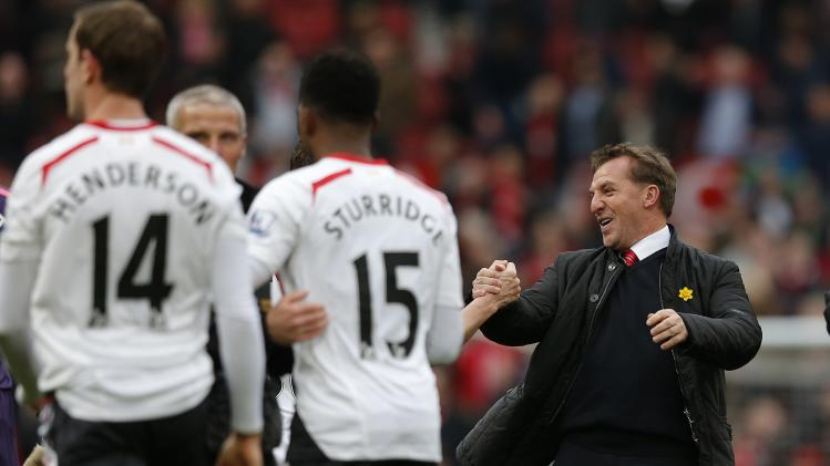 Liverpool's manager Rodgers celebrates with his players following their English Premier League soccer match against Manchester United at Old Trafford in Manchester