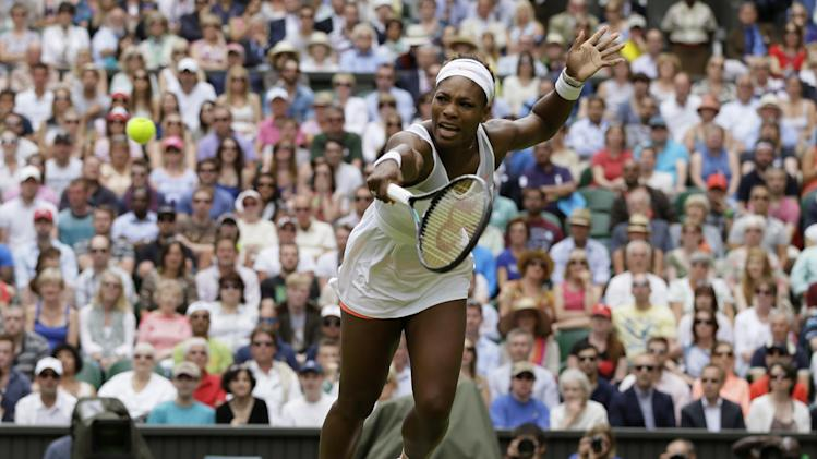 Serena Williams of the United States returns to Sabine Lisicki of Germany in a Women's singles match at the All England Lawn Tennis Championships in Wimbledon, London, Monday, July 1, 2013. (AP Photo/Alastair Grant)