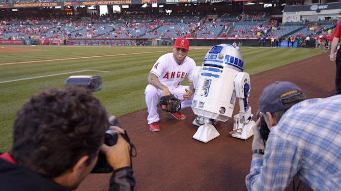 Los Angeles Angels' Hector Santiago poses with R2-D2 from the movie Star Wars during Star Wars Night prior to a baseball game between the Angels and the Oakland Athletics, Monday, April 20, 2015, in Los Angeles. (AP Photo/Mark J. Terrill)