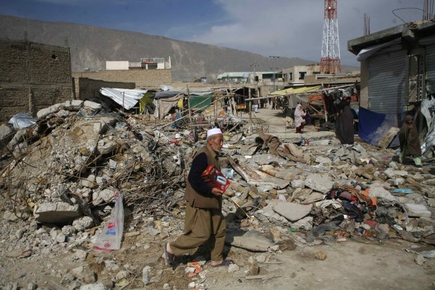 A resident from the Hazara community walks through the rubbles of last month bomb blast in Quetta