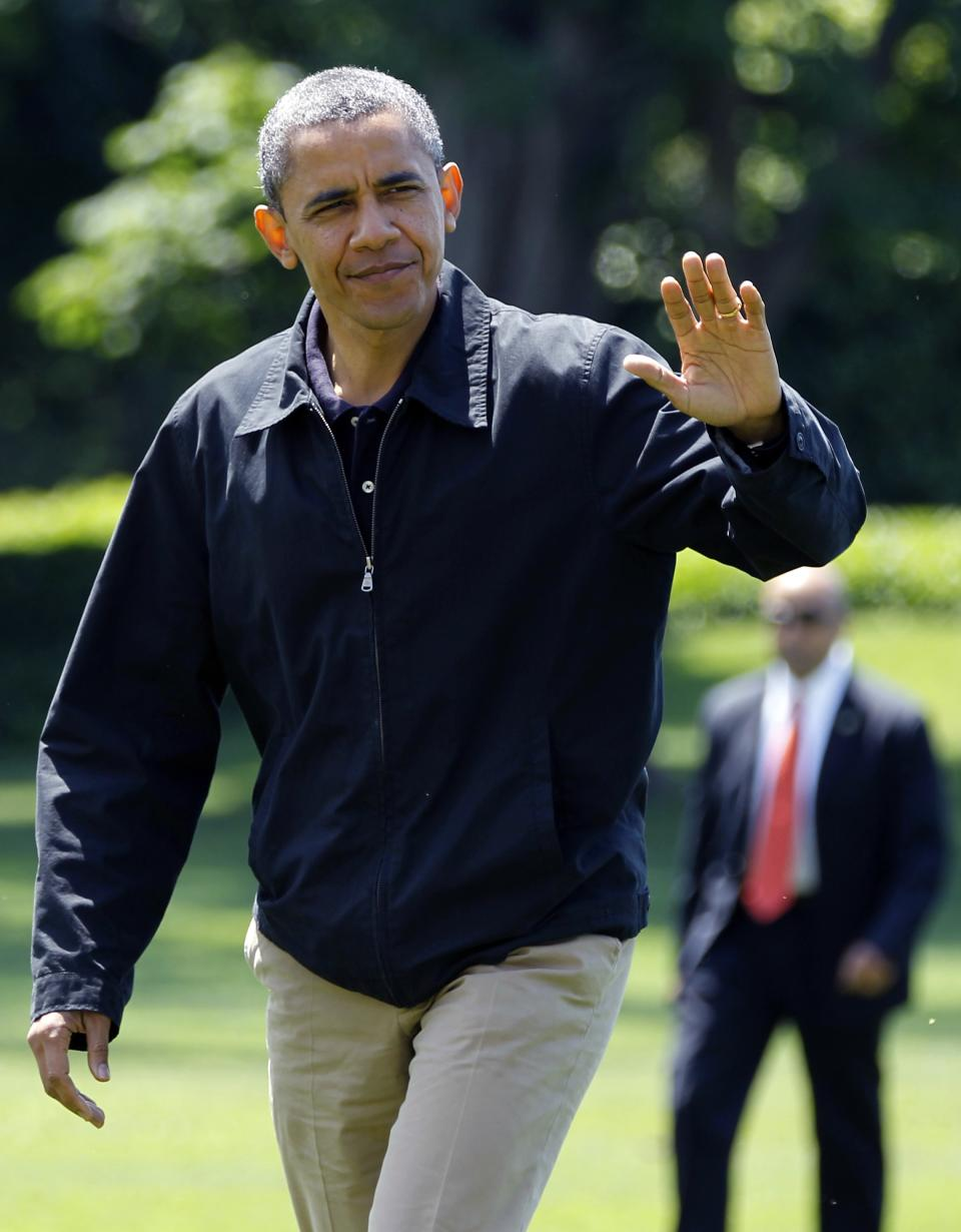 President Obama walks across the South Lawn of the White House, Sunday, June 3, 2012, in Washington, after returning from Camp David. (AP Photo/Haraz N. Ghanbari)