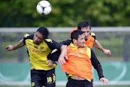 Dortmund striker Lucas Barrios (L) during a training session on May 11. Unbeaten in their last 22 games in all competitions since losing to Marseille in the Champions League last December, Dortmund have yet to lose in 2012