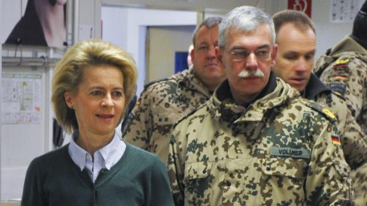 German Defence Minister von der Leyen and German General Vollmer, commander of the ISAF troops in Northern Afghanistan, queue for breakfast in Mazar-i-Sharif