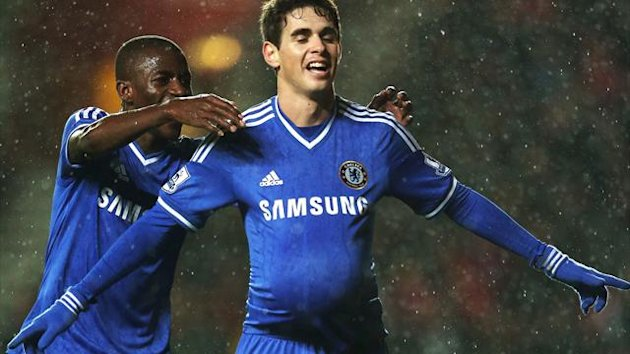 Oscar of Chelsea celebrates with teammate Ramires after scoring his team's third goal during the Barclays Premier League match between Southampton and Chelsea (PA)