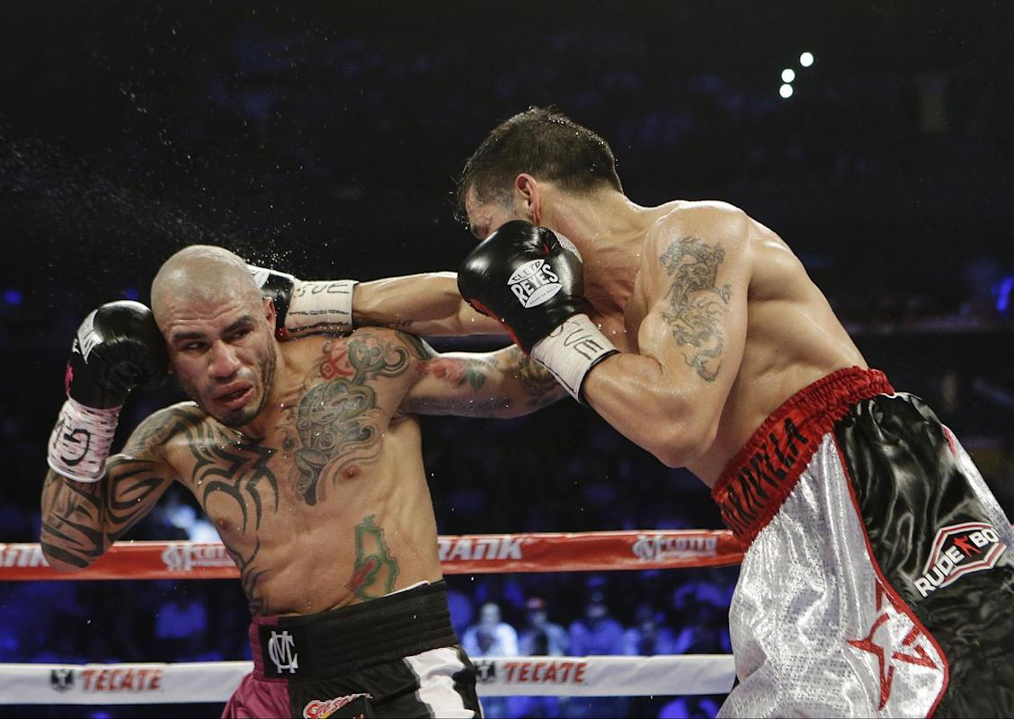 Sergio Martinez, of Argentina, punches Miguel Cotto, of Puerto Rico, during the first fifth round of a WBC World Middleweight Title boxing match Saturday, June 7, 2014, in New York