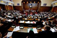 Serbian members of parliament attend a session in Belgrade on July 26, 2012. The parliament approved a revised 2013 budget on Friday, which will bring Serbia's deficit to 4.7 percent of the GDP, compared to an initially planned 3.3 percent.