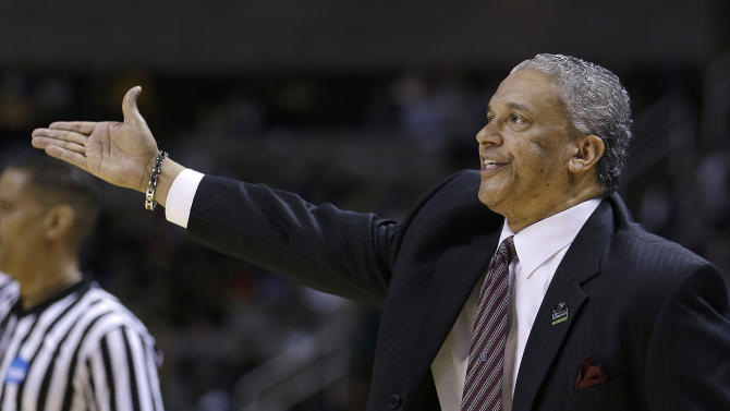 New Mexico State head coach Marvin Menzies gestures during the first half of a second-round game in the NCAA college basketball tournament against Saint Louis in San Jose, Calif., Thursday, March 21, 2013. (AP Photo/Ben Margot)