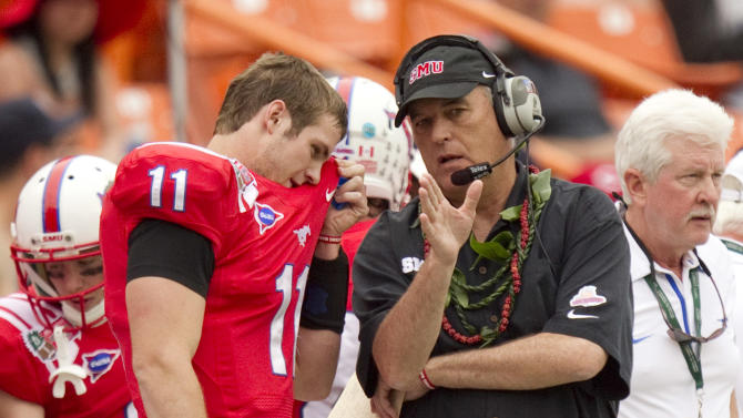 CORRECTS OPPONENT TO FRESNO STATE - SMU quarterback Garrett Gilbert (11) listens to coach June Jones in the first quarter against Fresno State in the Hawaii Bowl, an NCAA college football game Monday, Dec. 24, 2012, in Honolulu. (AP Photo/Eugene Tanner)