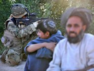 "<p>Afghan residents look on as a soldier from 1st Battalion the Royal Gurkha Rifles patrols in a village in Nahr e Saraj, Helmand on Saturday. Prime Minister David Cameron said he was ""deeply saddened"" by the killing of three British soldiers in Nahr-e-Saraj.</p>"