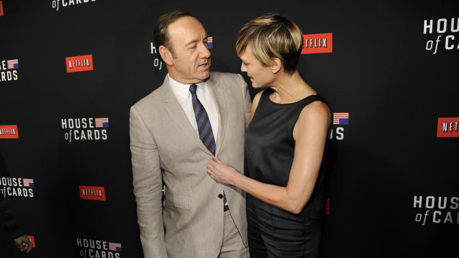 """Kevin Spacey, left, and Robin Wright arrive at a special screening for season 2 of """"House of Cards"""", on Thursday, Feb. 13, 2014 in Los Angeles. (Photo by Chris Pizzello/Invision/AP)"""