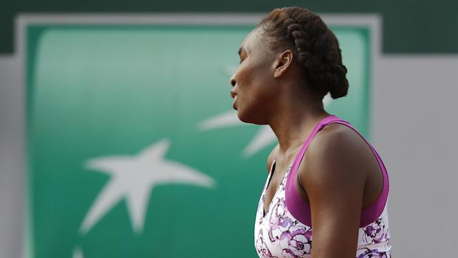 Venus Williams of the U.S. turns away after missing a return in the first round match of the French Open tennis tournament against Sloane Stephens of the U.S. at the Roland Garros stadium, in Paris, France, Monday, May 25, 2015. (AP Photo/Michel Euler)