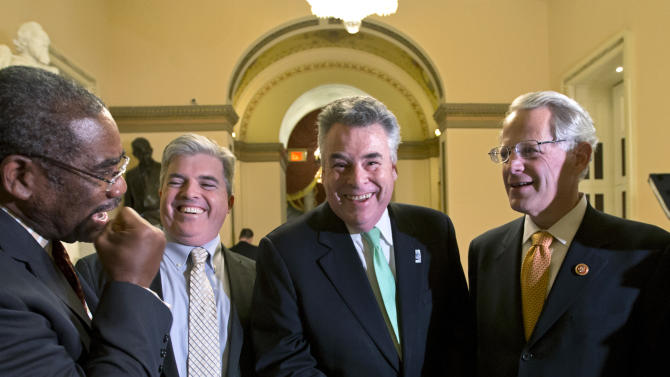 From left, Rep. Gregory W. Meeks, D-N.Y., Suffolk County, N.Y. Executive Steve Bellone, Rep. Peter King, R-N.Y., and Rep. Steve Israel, D-N.Y., celebrate just after the House of Representatives passed a $50.7 billion emergency aid bill for states hit by Superstorm Sandy., at the Capitol in Washington, Tuesday, Jan. 15, 2013.  (AP Photo/J. Scott Applewhite)