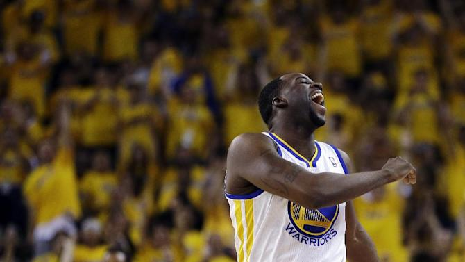 Golden State Warriors forward Draymond Green reacts after scoring against the Denver Nuggets during the first half of Game 4 in a first-round NBA basketball playoff series, Sunday, April 28, 2013, in Oakland, Calif. (AP Photo/Ben Margot)