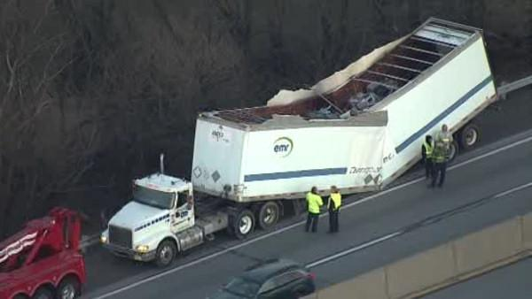 Tractor-trailer loses roof on NE Extension