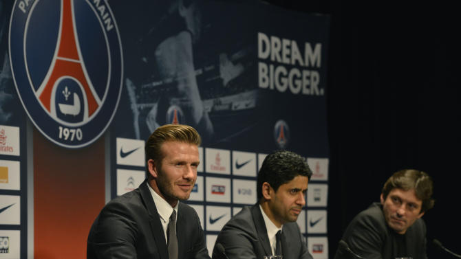 British soccer player David Backham, left, speaks during a press conference whileParis Saint Germain's President Nasser Al-Khelaifi, center, and Sports Director Leonardo, right, sits next to him at the Parc des Princes stadium in Paris, Thursday, Jan. 31, 2013. David Beckham will join Paris Saint-Germain on Thursday, opting for a move to France after mulling over lucrative offers from around the world since leaving the Los Angeles Galaxy.(AP Photo/Benjamin Girette)
