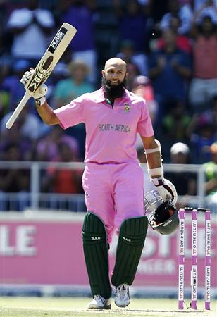 South Africa's batsman Hashim Amla celebrates his century during their third One Day International (ODI) cricket match against Pakistan in Johannesburg