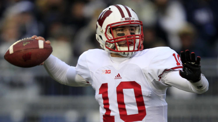 Wisconsin quarterback Curt Phillips (10) passes during the first quarter of an NCAA college football game against Penn State in State College, Pa., Saturday, Nov. 24, 2012. (AP Photo/Gene J. Puskar)