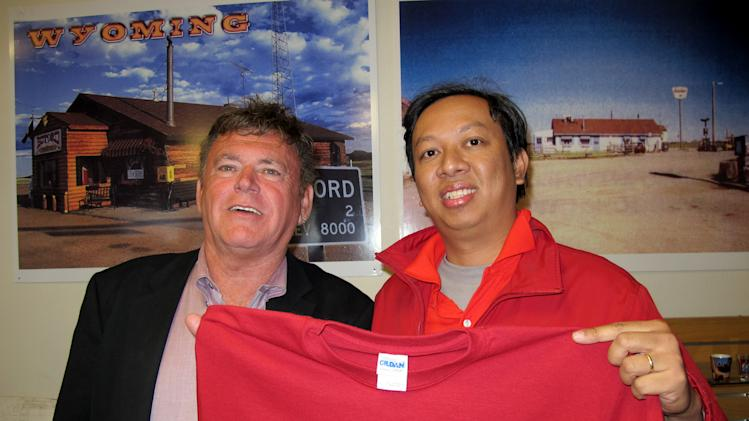 """In this photo taken Saturday, April 7, 2012, Vietnamese businessman Pham Dinh Nguyen, right, poses with Don Sammons, who was the self-proclaimed """"mayor"""" and sole inhabitant in Buford, Wyo., U.S.A. Nguyen, 38, flew to the U.S. for the first time, drove to a tiny, frigid trading outpost and bought his own piece of the American dream: Buford, Wyoming _ population 1. Nguyen's name was not released last week when he won the auction for Buford _ billed as the nation's smallest town _ but he has since drawn attention in Vietnamese media and on social networks. Many are lauding him for showing the world that Vietnam has moved far beyond war and poverty. (AP Photo/Tuoi Tre Newspaper)  EDITORIAL USE ONLY"""