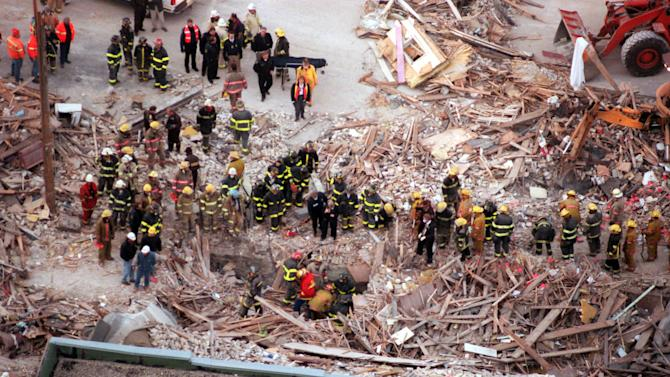In this Dec. 11, 1998 photo, authorities search for victims of a gas explosion that killed four and leveled six buildings in downtown St. Cloud, Minn. An Associated Press investigation has found since 1968, there have been at least 270 natural gas accidents in the U.S. that could have been prevented or made less dangerous by an inexpensive valve that cuts off leaking gas. At least 67 people have been killed and more than 350 hurt. Yet nearly 90 percent of the nation's gas service lines aren't fitted with the valves. (AP Photo/The Minneapolis Star Tribune, Richard Sennot)