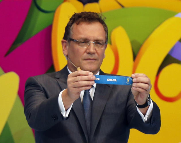 "FIFA Secretary General Jerome Valcke holds the slip showing ""Ghana"" during the draw for the 2014 World Cup at the Costa do Sauipe resort in Sao Joao da Mata"