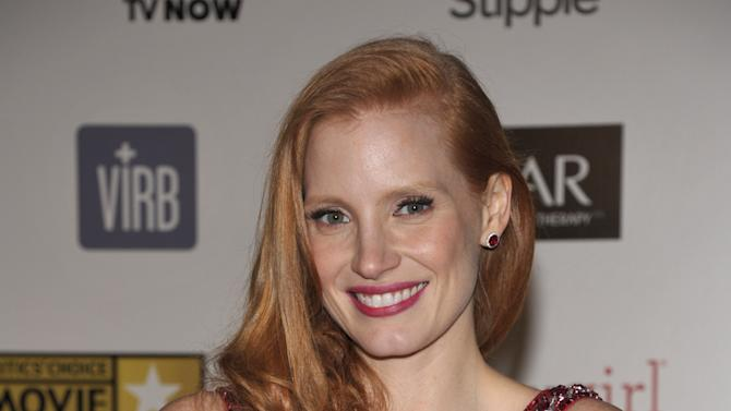 """Jessica Chastain poses backstage with the award for best actress for """"Zero Dark Thirty"""" at the 18th Annual Critics' Choice Movie Awards at the Barker Hangar on Thursday, Jan. 10, 2013, in Santa Monica, Calif. (Photo by John Shearer/Invision/AP)"""