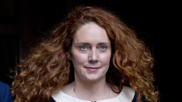 Rebekah Brooks, former chief executive of News International leaves the High Court in London after giving evidence to the Leveson Inquiry, Friday, May 11, 2012. The Leveson Inquiry is Britain's media ethics probe that was set up in the wake of the scandal over phone hacking at Rupert Murdoch's News of the World, which was shut in July 2011 after it became clear that the tabloid had systematically broken the law. (AP Photo/Sang Tan)