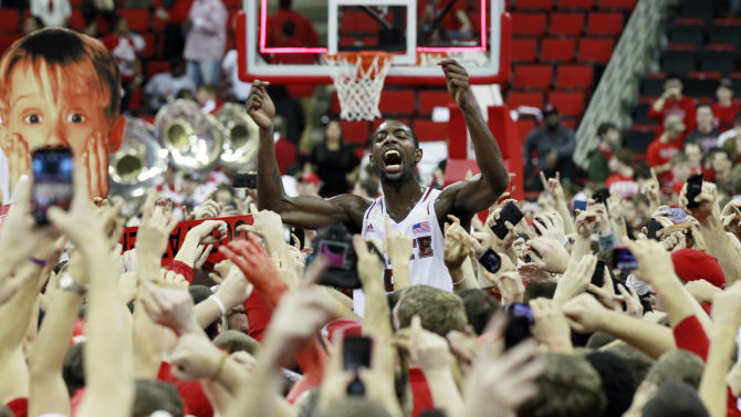 North Carolina State's C.J. Leslie (5) celebrates with the fans after the Wolfpack's  84-76 win over top-ranked Duke in Raleigh, N.C., Saturday, Jan. 12, 2013. (AP Photo/The News & Observer, Ethan Hyman)  MANDATORY CREDIT