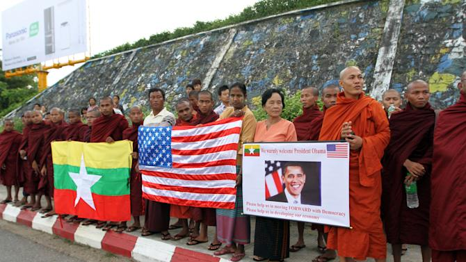 Myanmar Buddhist monks wait to welcome the arrival of U.S. President Barack Obama at Yangon International airport Monday, Nov. 19, 2012, in Yangon, Myanmar. (AP Photo/Khin Maung Win)