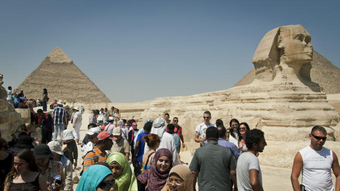 In this Thursday, Sept. 27, 2012 photo, foreign tourists visit the historical site of the Giza Pyramids, near Cairo, Egypt. The Egyptian demonstrations against an online film that was produced by a U.S. citizen originally from Egypt and denigrates the Prophet Muhammad were part of a wider explosion of anger in Muslim countries. They happened near the U.S. Embassy, far from the pyramids of Giza on Cairo's outskirts, and a lot further from gated Red Sea resorts, cocoons for the beach-bound vacationer. Yet the online or TV images _ flames, barricades, whooping demonstrators _ are a killjoy for anyone planning a getaway, even though the protests have largely subsided. Tour guides in Egypt say tourist bookings are mostly holding, but they worry about a dropoff early next year, since people tend to plan several months ahead.(AP Photo/Khalil Hamra)