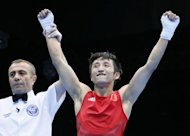 China&#39;s defending world and Olympic champion Zou Shiming won the men&#39;s light flyweight (46-49kg) gold on Saturday with a 13-10 win over Thailand&#39;s Kaeo Pongprayoon