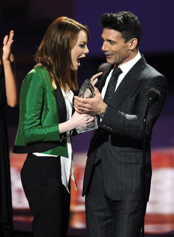 Emma Stone accepts the award for favorite movie actress during the People's Choice Awards on Wednesday, Jan. 11, 2012 in Los Angeles. (AP Photo/Chris Pizzello)