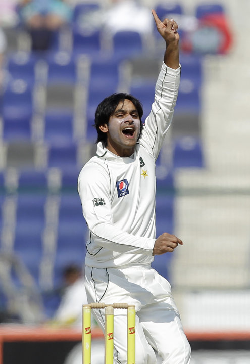 Pakistan's Mohammad Hafeez celebrates taking the wicket of England's James Anderson, not pictured, lbw during the third day of the second cricket test match of a three match series between England and