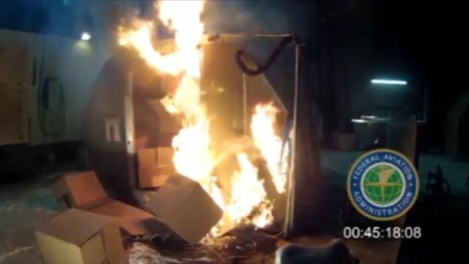 File-This file frame grab from video, provided by the Federal Aviation Administration (FAA) shows a test at the FAAs technical center in Atlantic City, N.J. last April, where a cargo container was packed with 5,000 rechargeable lithium-ion batteries. Citing safety concerns, United Airlines on Monday, March, 2, 2015, became the second major U.S. airline to announce it will no longer accept bulk shipments of rechargeable batteries of the kind that power everything from smartphones to laptops to power tools. (AP Photo/FAA, File)