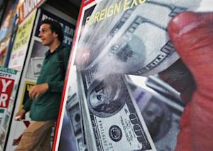 A tourist leaves a currency exchange shop at a shopping arcade in New Delhi