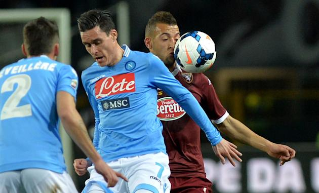 Torino midfielder Omar El Kaddouri, right, challenges for the ball with Napoli's Jose Callejon during a Serie A soccer match at the Olympic stadium, in Turin, Italy, Monday, March 17, 2014