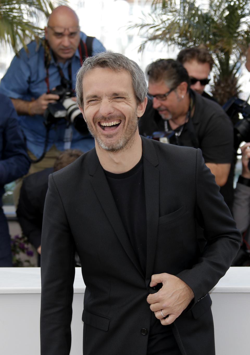 Director Jerome Salle poses for photographers during a photo call for the film Zulu at the 66th international film festival, in Cannes, southern France, Sunday, May 26, 2013. (AP Photo/Lionel Cironneau)