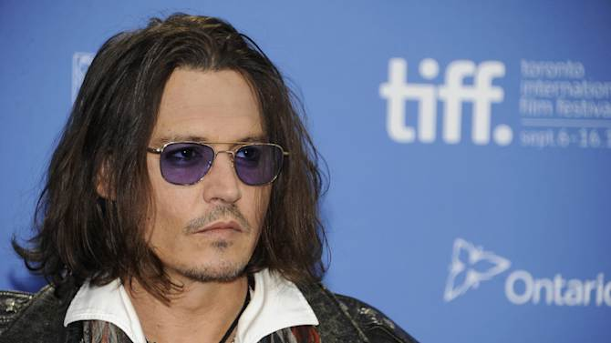 """FILE - In this Sept. 8, 2012 file photo, actor Johnny Depp participates in a photo call and press conference for the film """"West of Memphis"""" at TIFF Bell Lightbox during the Toronto International Film Festival, in Toronto. HarperCollins Publishers announced Monday, Oct. 15, 2012, that Depp will help run an imprint that will be a home for """"authentic, outspoken and visionary"""" books. (Photo by Evan Agostini/Invision/AP, File)"""