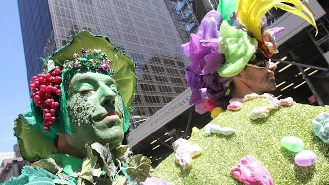 Dressed for the occasion, Paul Nagle, left, poses for photographs as he takes take part in the Easter Parade along New York's Fifth Avenue, Sunday, April 20, 2014. (AP Photo/Tina Fineberg)