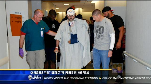 Chargers visit wounded detective in hospital