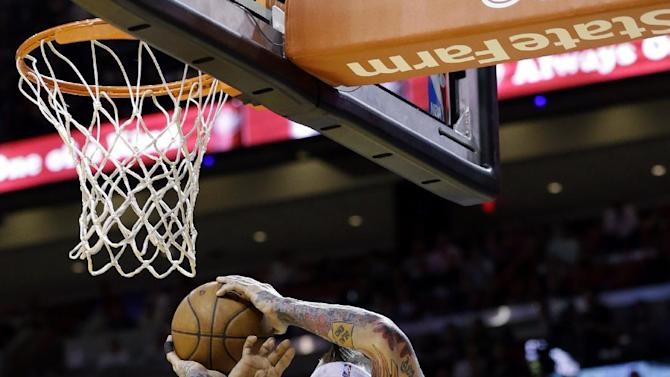 Miami Heat forward Chris Andersen (11) goes up for a shot against New York Knicks forward Kenyon Martin, rear, and guard Jason Kidd (5) during the first half of an NBA basketball game, Tuesday, April 2, 2013 in Miami. (AP Photo/Wilfredo Lee)