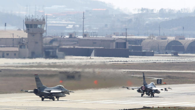 In this Wednesday, April 10, 2013 photo, U.S. Air Force F-16 fighter jets prepare to take off from a runway during their military exercise at the Osan U.S. Air Base in Osan, South Korea. The names of U.S.-South Korean war games staged over the years don't sound all that threatening: Team Spirit, Ulchi Focus Lens, Key Resolve ... Foal Eagle. But whatever they're called, the annual show of force is guaranteed to get a rise out of Pyongyang.  (AP Photo/Ahn Young-joon)