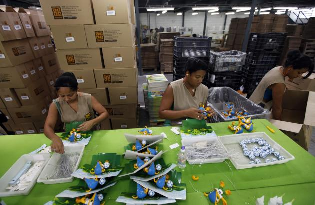 Employees make toys of Fuleco the Armadillo, the official mascot of the FIFA 2014 World Cup, at a factory in Sao Bernardo do Campo