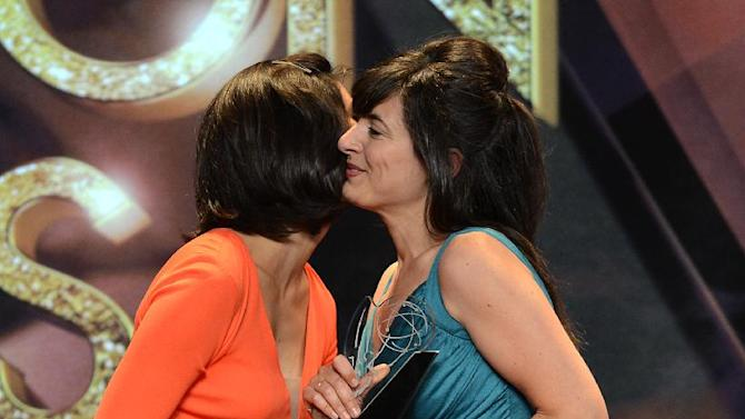 "Susanna Casares Domingo (R) of the University of California-Los Angeles accepts the 'Drama' College Television Award for ""Tryouts"" from actor Morena Baccarin onstage at the 34th College Television Awards presented by the Academy of Television Arts & Sciences Foundation at the JW Marriott Los Angeles L.A. Live on April 25, 2013 in Los Angeles, California. (Photo by Phil McCarten/Invision for the Academy of Television Arts & Sciences/AP Images)"