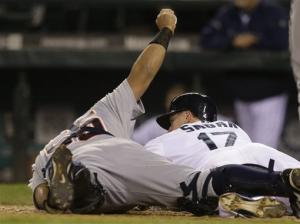 Tigers hold on at plate, edge Mariners 2-1 in 14