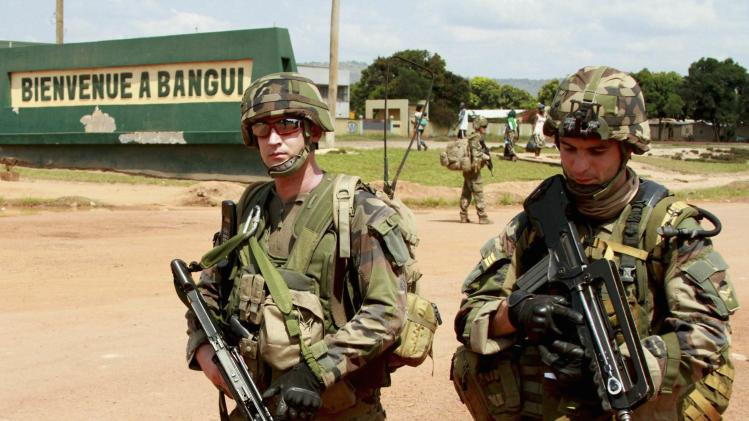 French soldiers patrol on foot at the entrance to the airport in Bangui