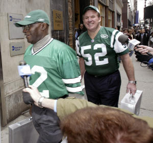 FILE - In this March 21, 2005, file photo, Former New York Jets players Emerson Boozer, left, and John Schmitt carry the team's bid to build a new stadium on Manhattan's west side to the transit authority's offices in New York. A Super Bowl ring lost four decades ago off Waikiki will soon be returned to former New York Jets center Schmitt. (AP Photo/Gregory Bull, File)