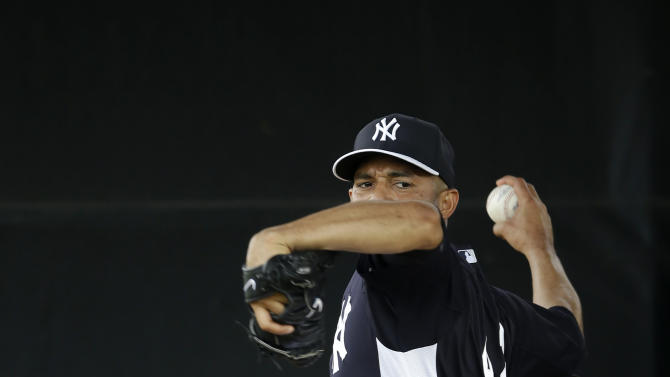 New York Yankees' Mariano Rivera throws in the bullpen during a workout at baseball spring training, Wednesday, Feb. 13, 2013, in Tampa, Fla. (AP Photo/Matt Slocum)