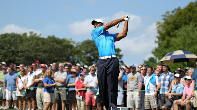 Tiger Woods tees off on the third hole during the second round of the Deutsche Bank Championship PGA golf tournament at TPC Boston in Norton, Mass., Saturday, Sept. 1, 2012. (AP Photo/Stew Milne)